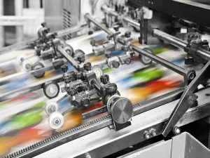 Printed Products Closeup Image of an Offset Printer Running
